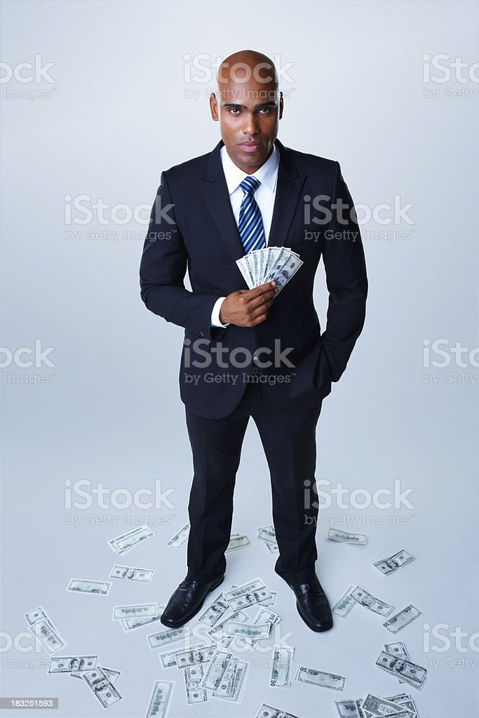 Business man made profit from investments against white royalty-free stock photo