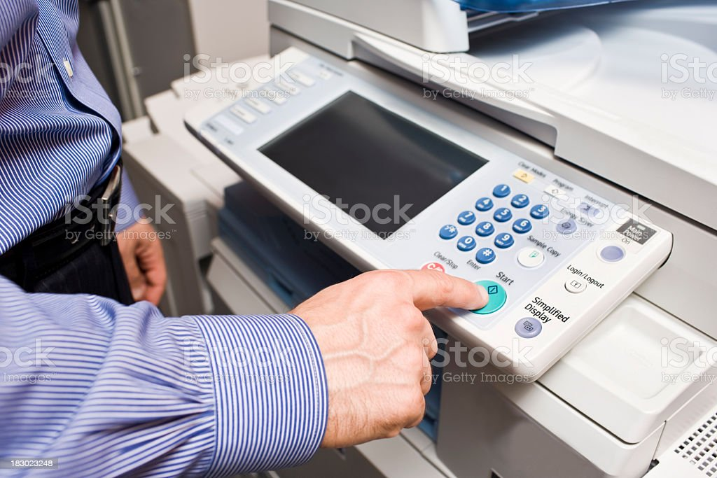 Business man making a Photocopy at the photocopier stock photo