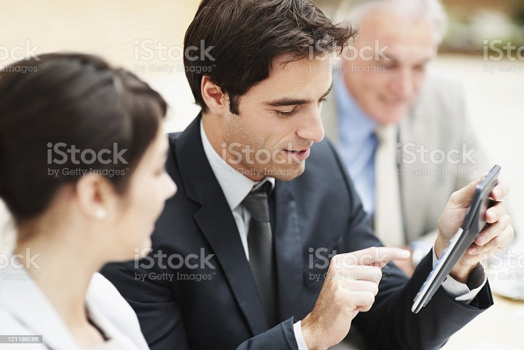 Business man making calculations during a meeting royalty-free stock photo