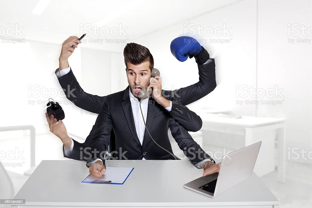 Business man multitasking with six arms stock photo