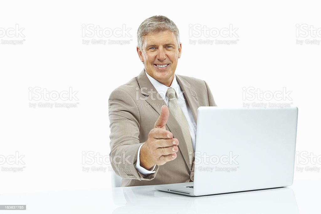 Business man offering a handshake royalty-free stock photo