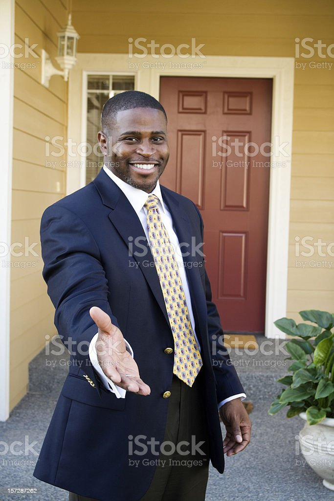 Business man offering a warm handshake royalty-free stock photo