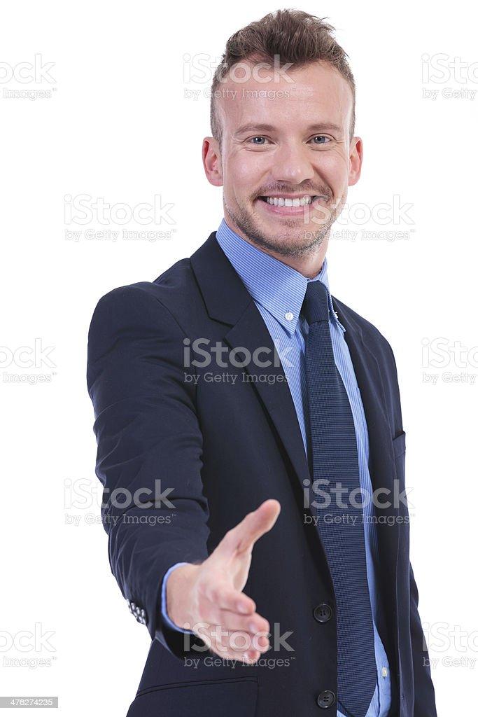 business man offers handshake royalty-free stock photo