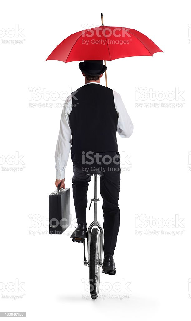 Business Man on a Unicycle Holding an Umbrella stock photo
