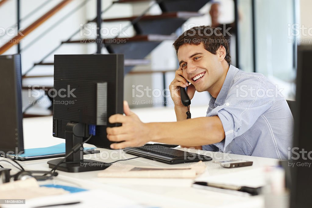 Business man on call while looking at computer royalty-free stock photo