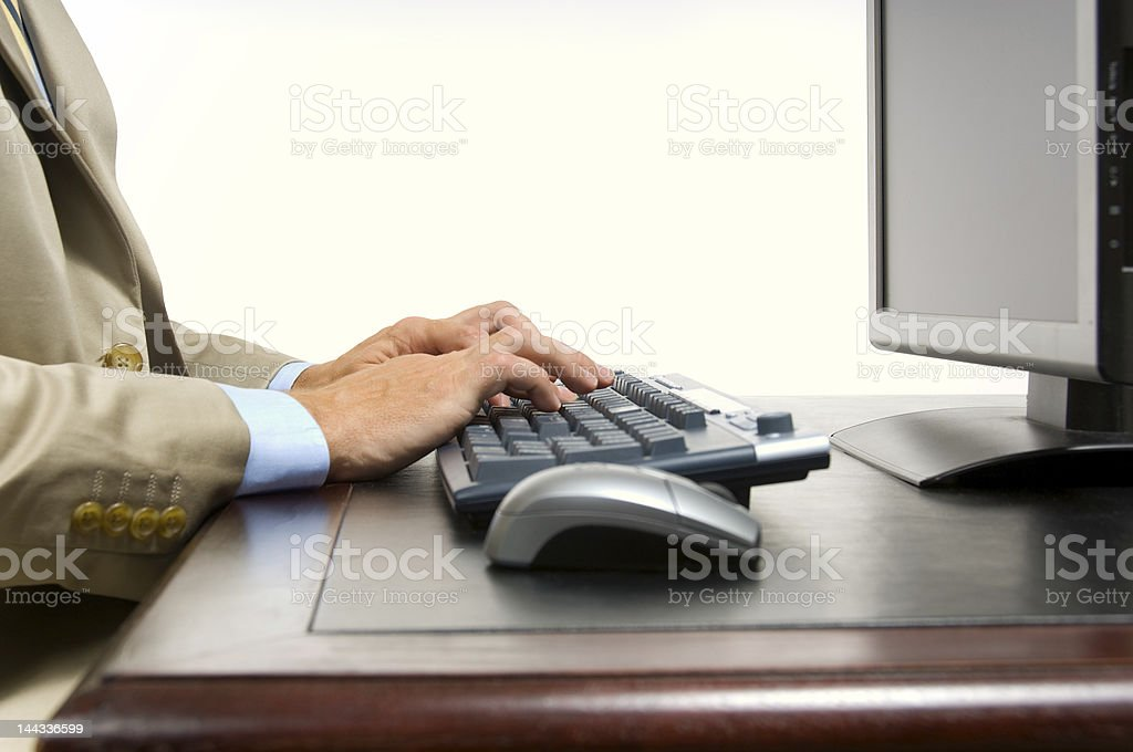 Business man on computer stock photo