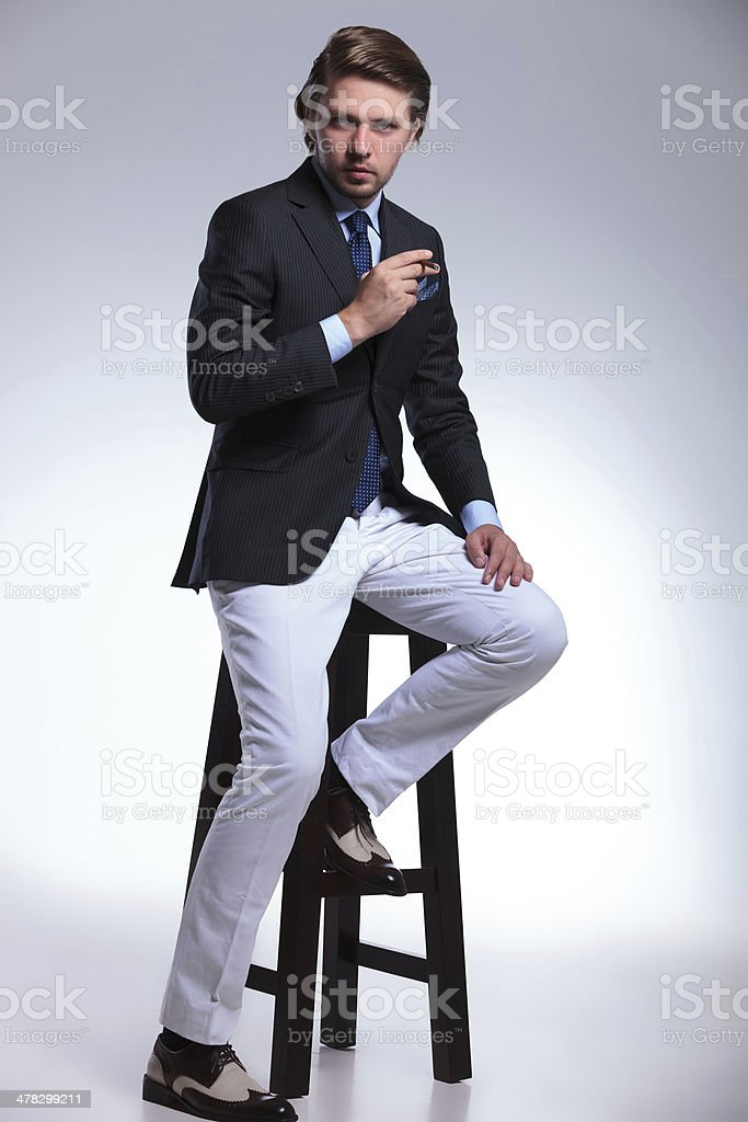 business man on high chair with cigarette royalty-free stock photo