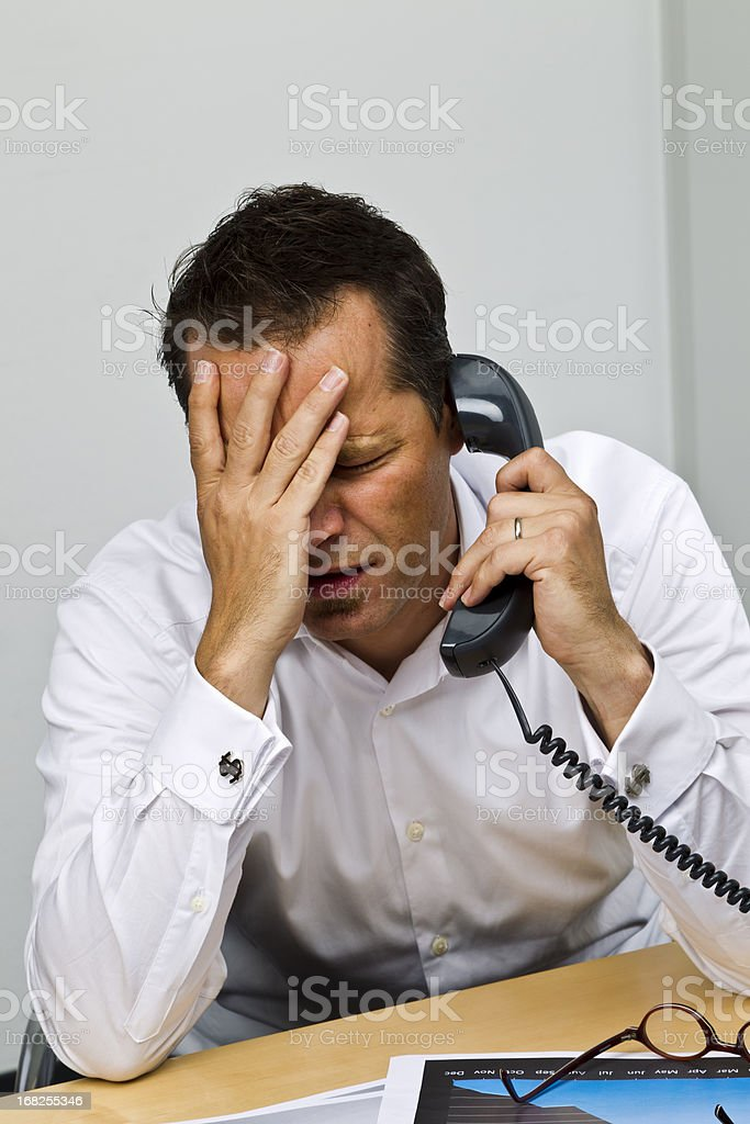 Business man  on phone in office royalty-free stock photo