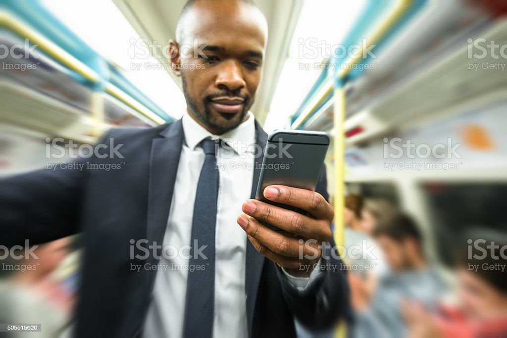 Business man on the phone inside the london tube metro stock photo
