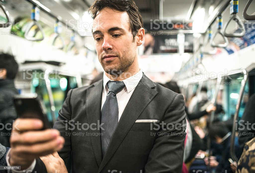 Business man on the phone on tokyo metro train stock photo
