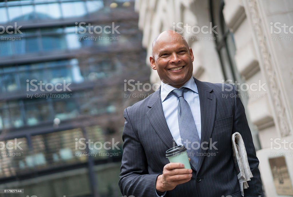 Business man on the street with coffee to go stock photo