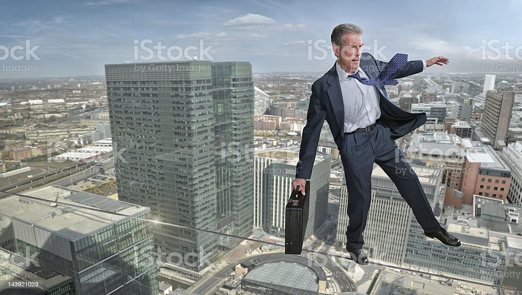 Business Man on Tightrope stock photo