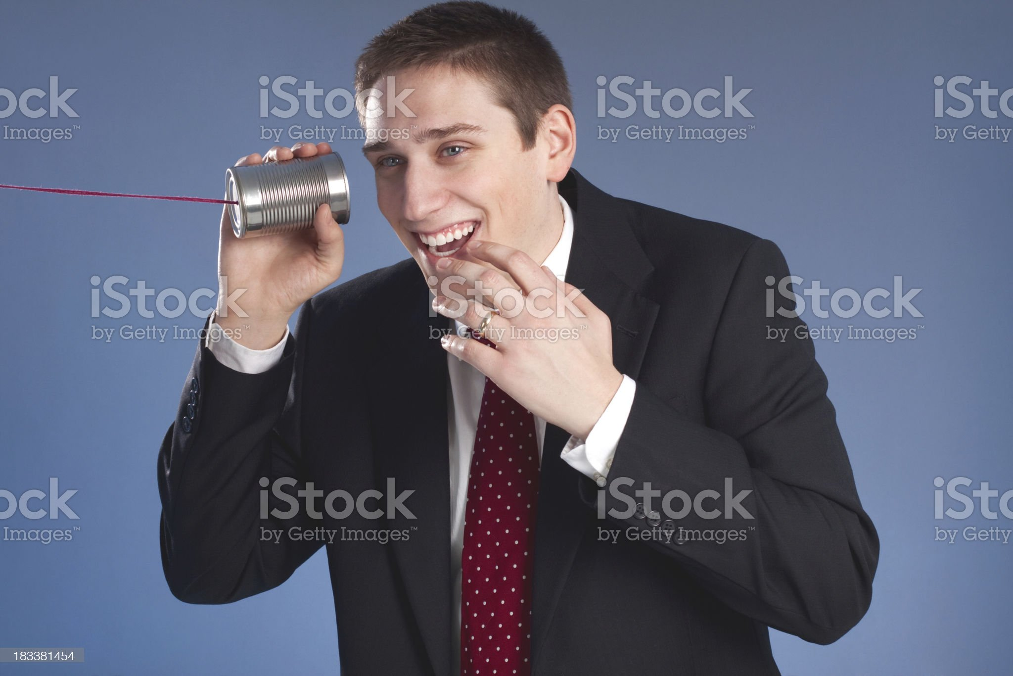Business Man on Tin Can Phone royalty-free stock photo