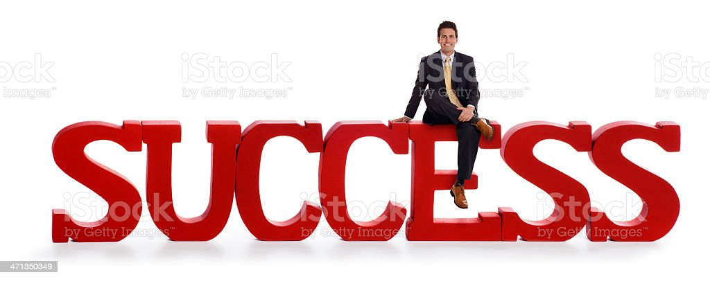 Business Man on top of a Red Success Sign stock photo