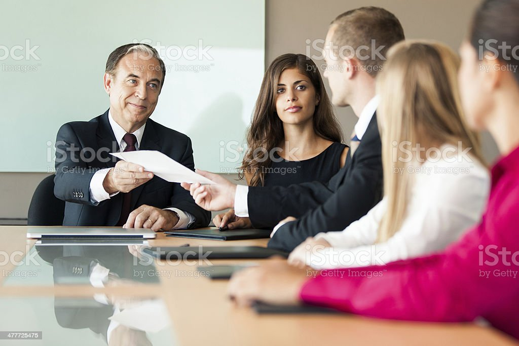 Business man passing document forward royalty-free stock photo