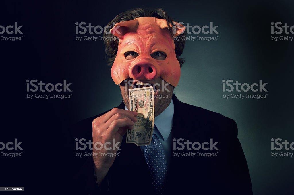 Business Man Pig Eating Money stock photo