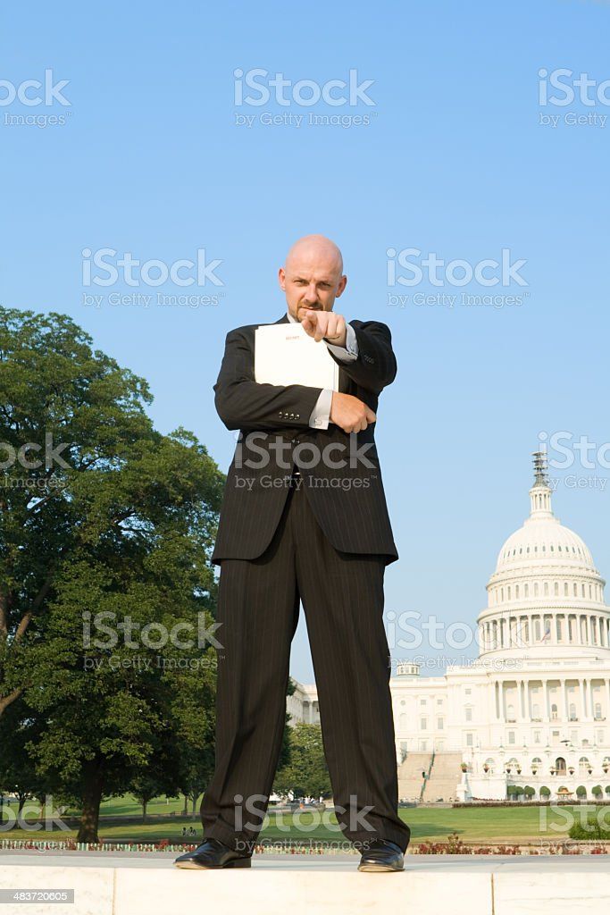 Business Man Pointing at Camera in Front of U.S. Capitol royalty-free stock photo