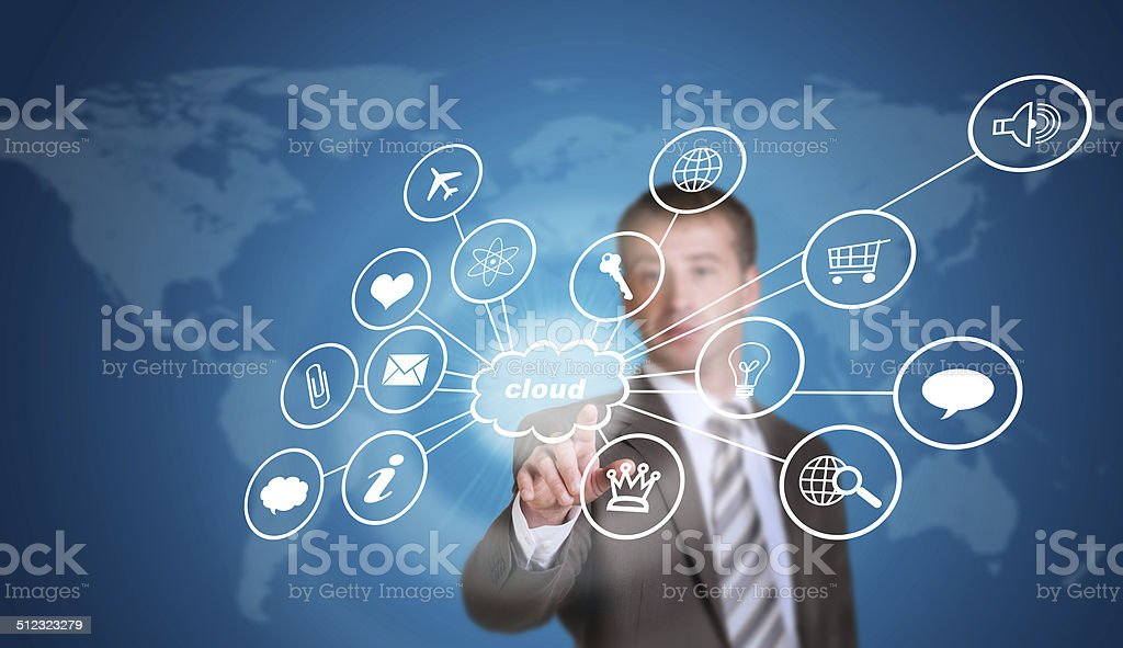 Business man pointing her finger at cloud with computer icons stock photo
