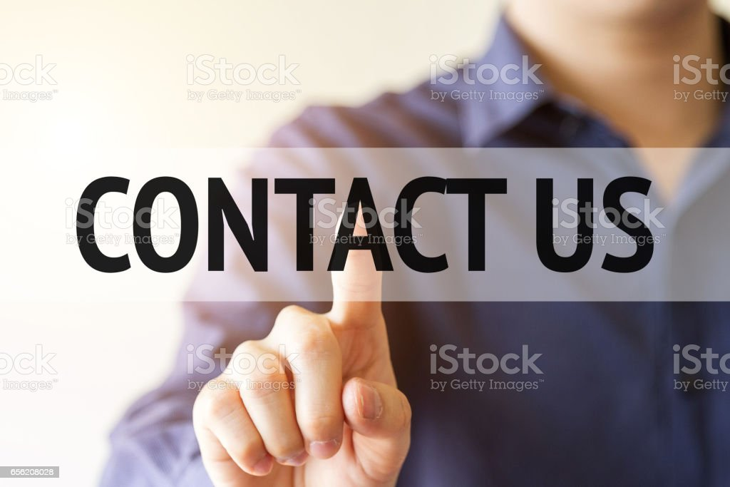 business man pointing on virtual screen with text word: contact us stock photo
