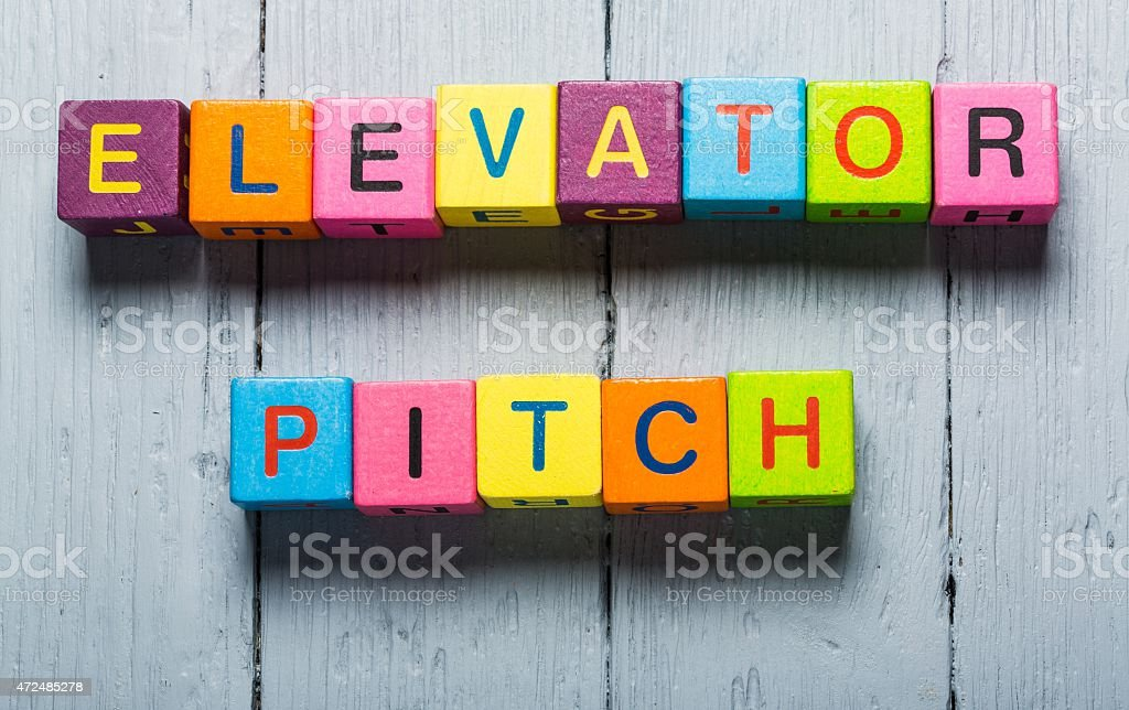 Business man pointing to transparent board with text: Elevator Pitch stock photo