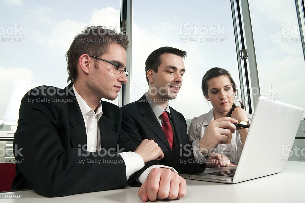 business man points with pen on laptop royalty-free stock photo
