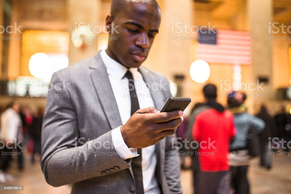 business man portrait in nyc sending sms stock photo