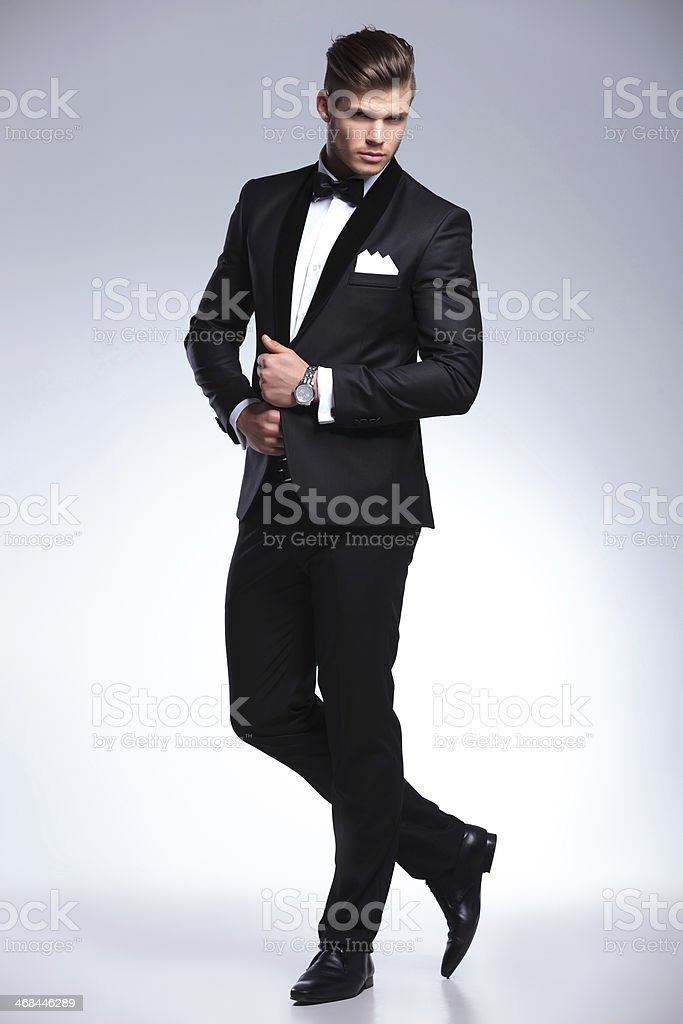 business man posing with bith hands on jacket stock photo