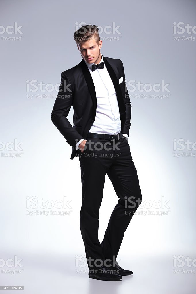 business man posing with hands in pockets royalty-free stock photo