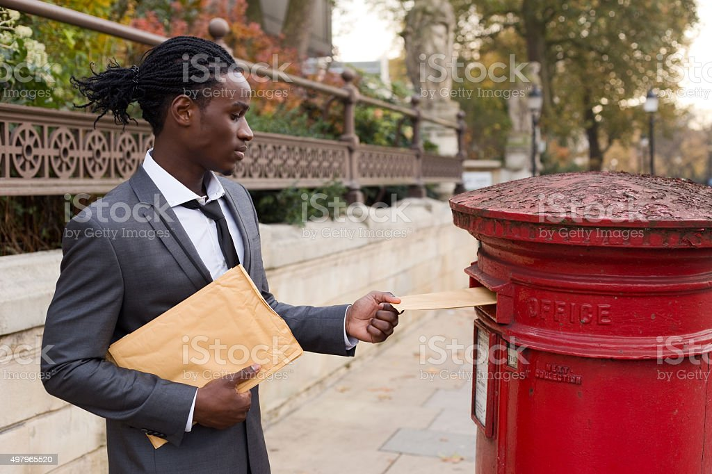business man posting letters stock photo