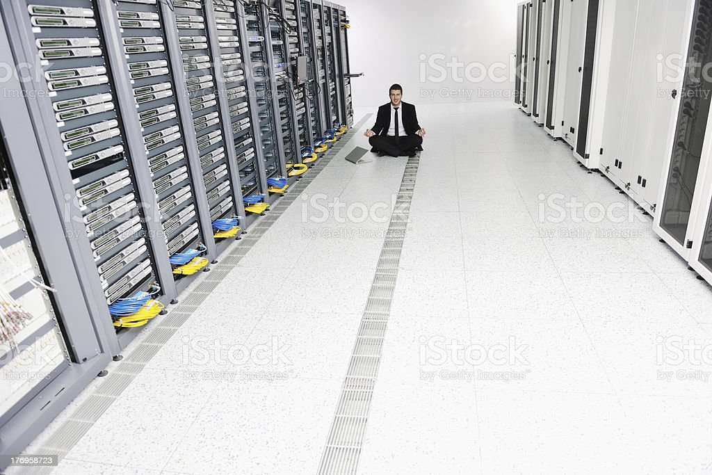 business man practice yoga at network server room royalty-free stock photo