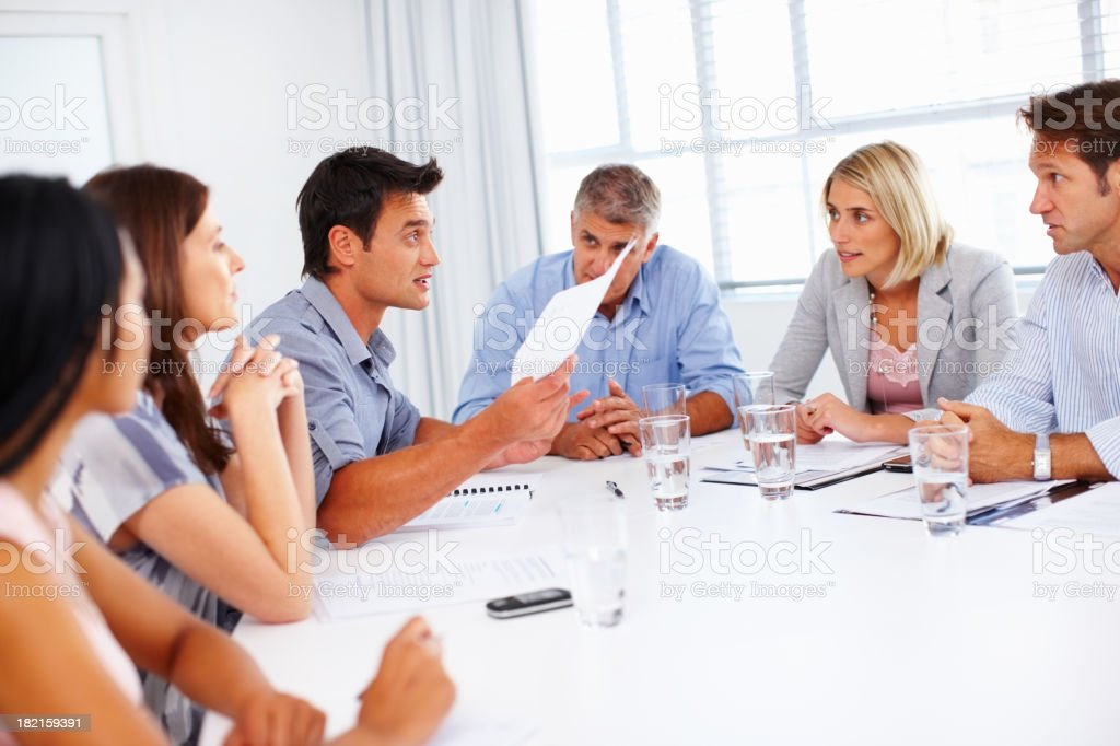 Business man presenting ideas in meeting royalty-free stock photo