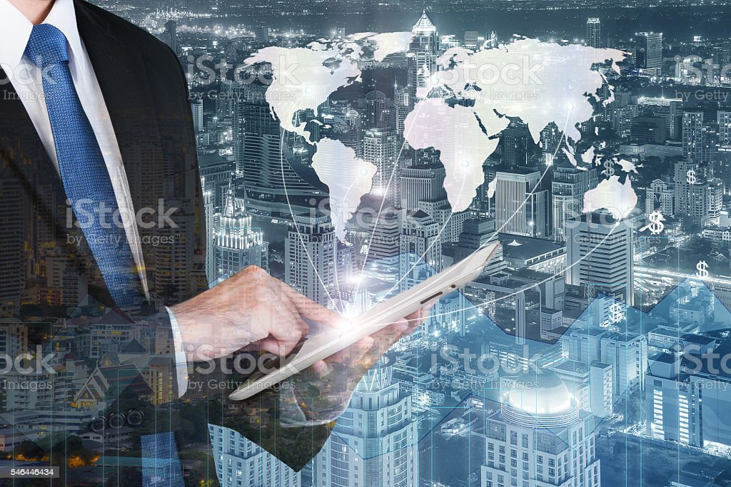 Business man press digital tablet to show global network partnership stock photo