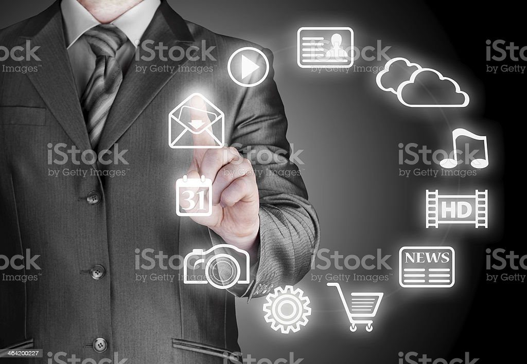 Business man pressing an icon in air stock photo