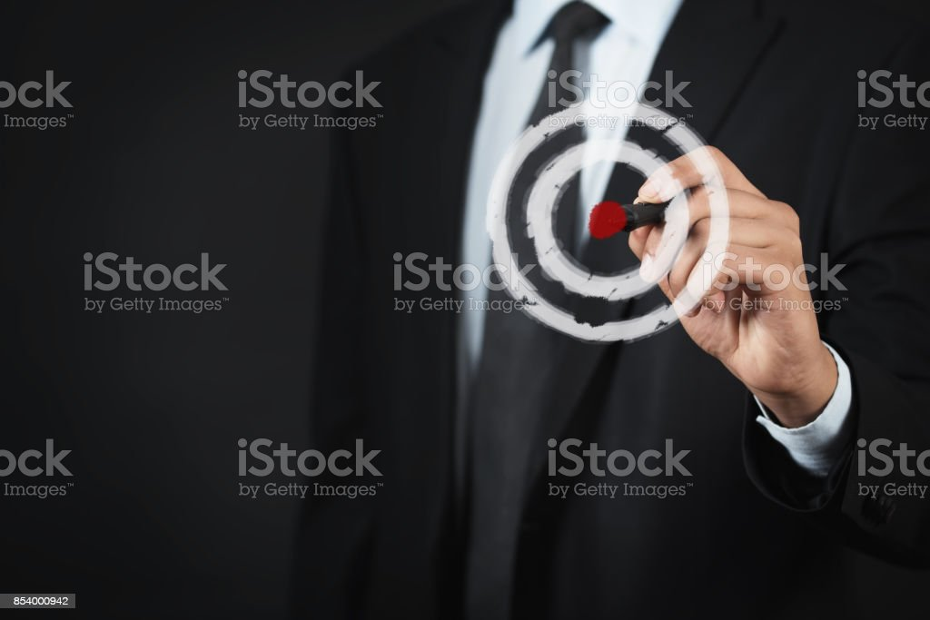 Business man pressing on target goal. stock photo