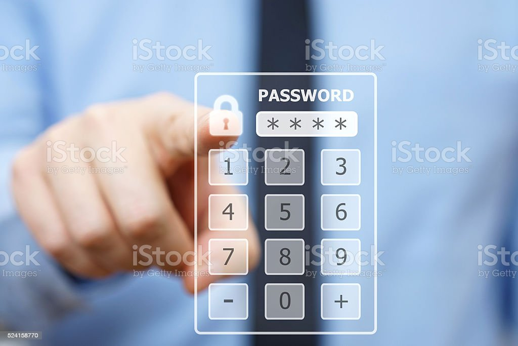 Business man pressing security code on virtual keypad stock photo