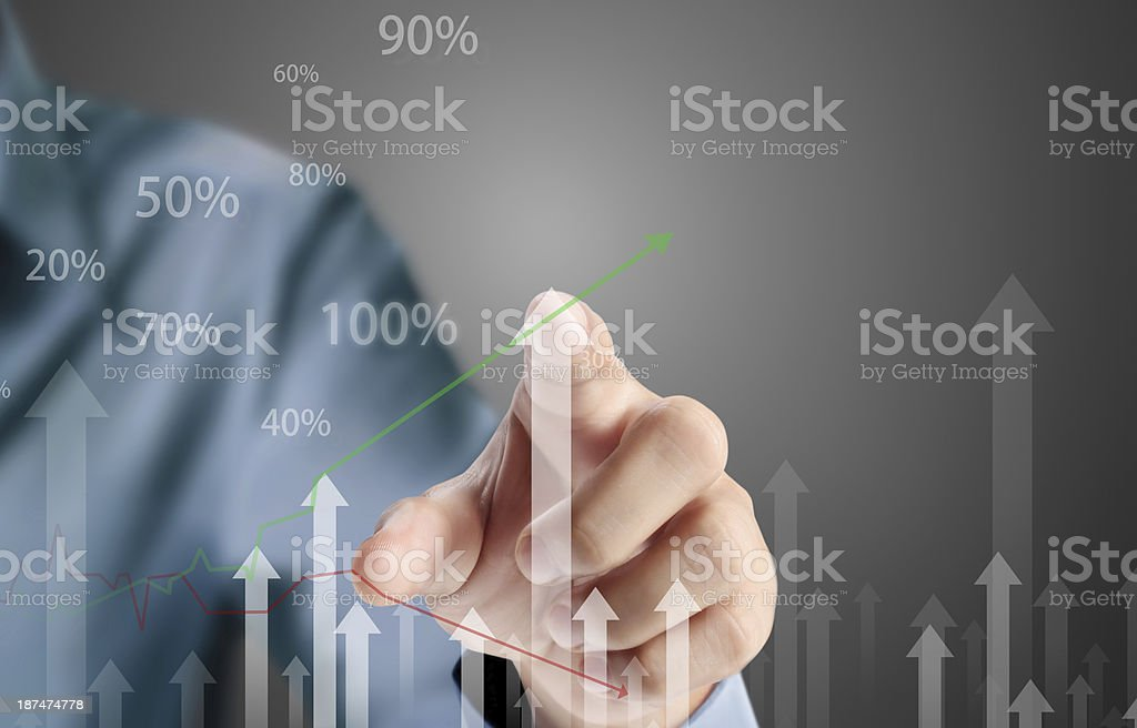 Business man pushing graph stock photo
