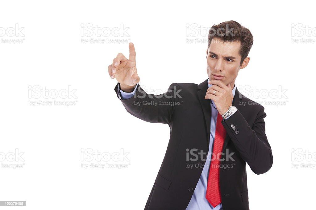 business man pushing imaginary digital button royalty-free stock photo