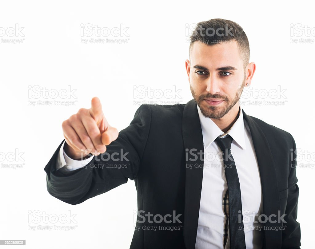 Business man pushing invisible button on white background. stock photo