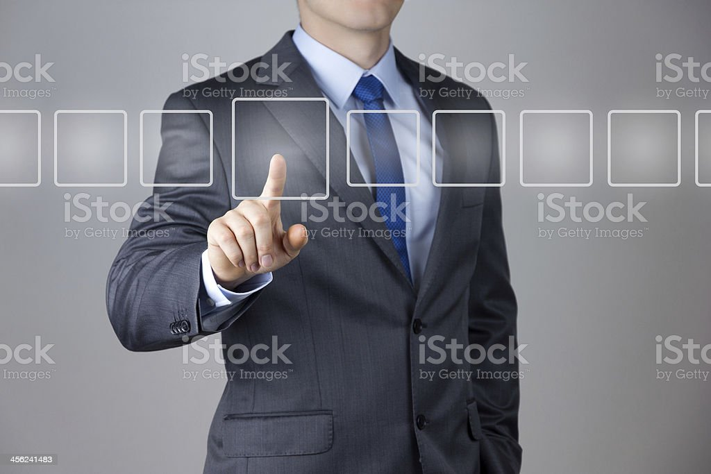 Business Man pushing on a touch screen interface stock photo