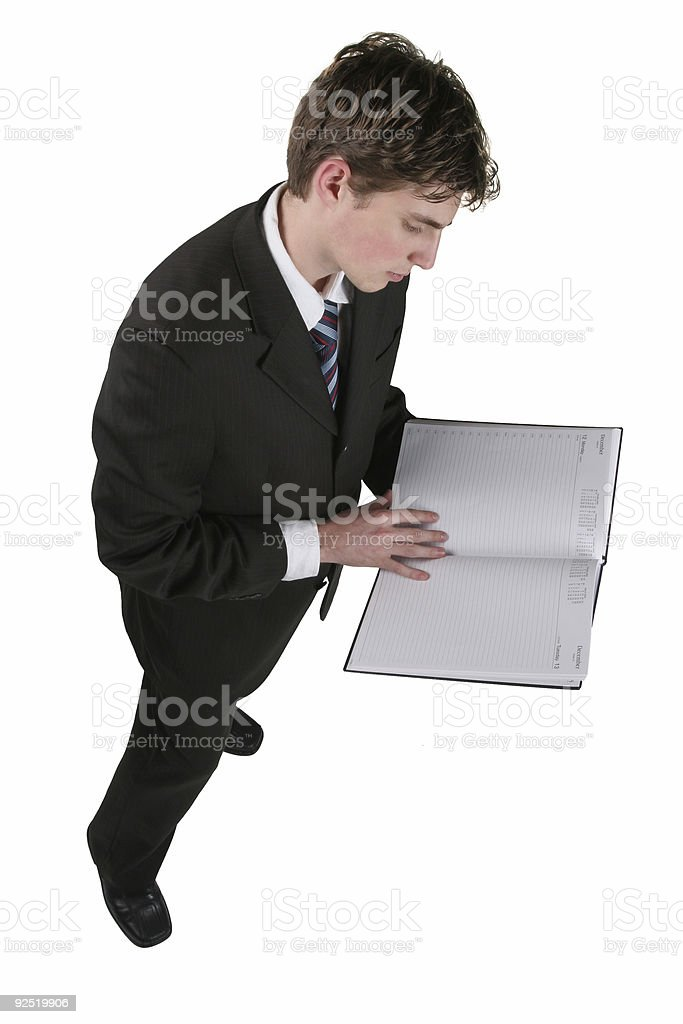 Business man reading a book stock photo