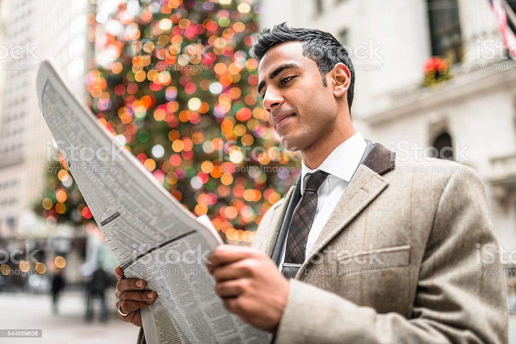 business man reading a newspaper in manhattan stock photo