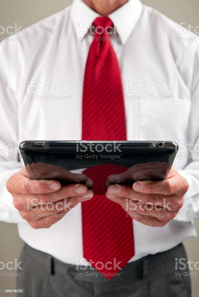 Business Man Reading Digital Tablet royalty-free stock photo