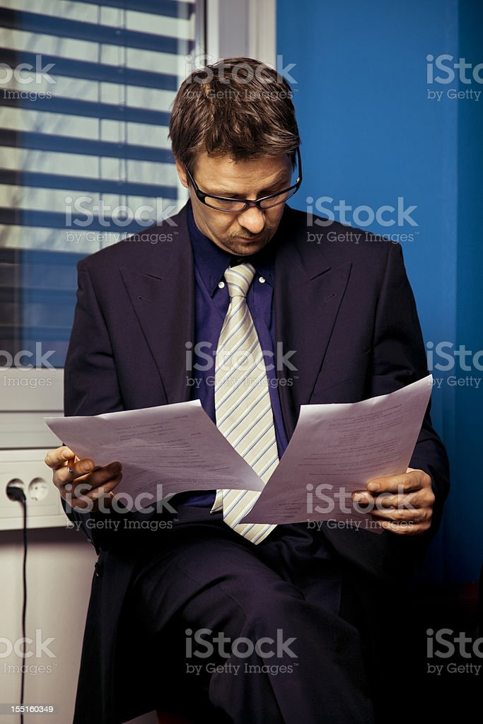 Business man reading reports royalty-free stock photo