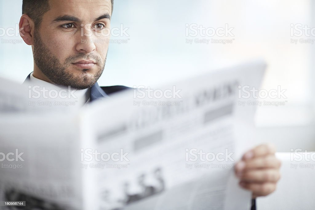 A business man reading the newspaper royalty-free stock photo