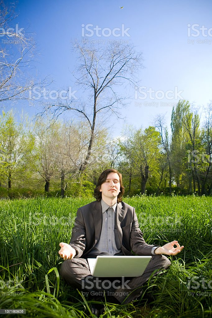 business man relax on the grass field royalty-free stock photo