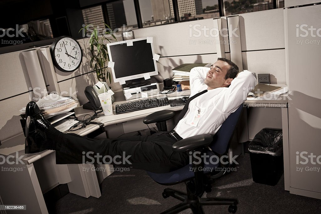 Business Man relaxing in Office Cubicle royalty-free stock photo