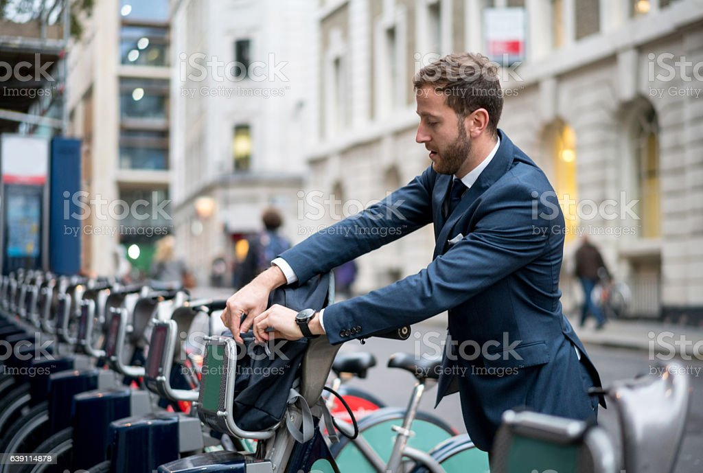Business man renting a bike in London stock photo