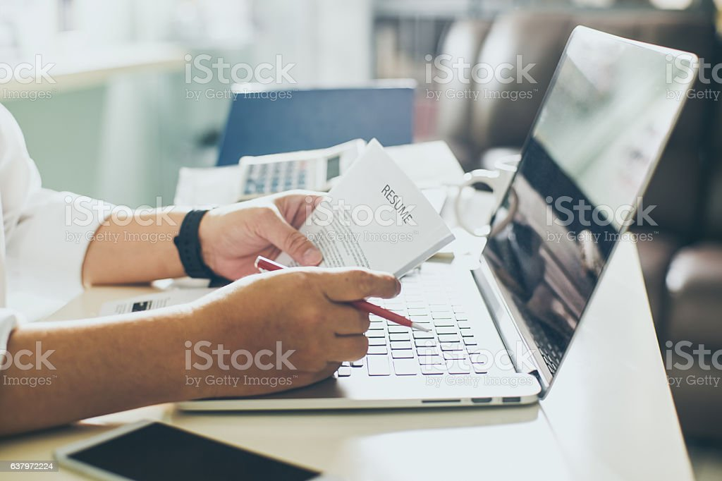 Business man review his resume on his desk stock photo
