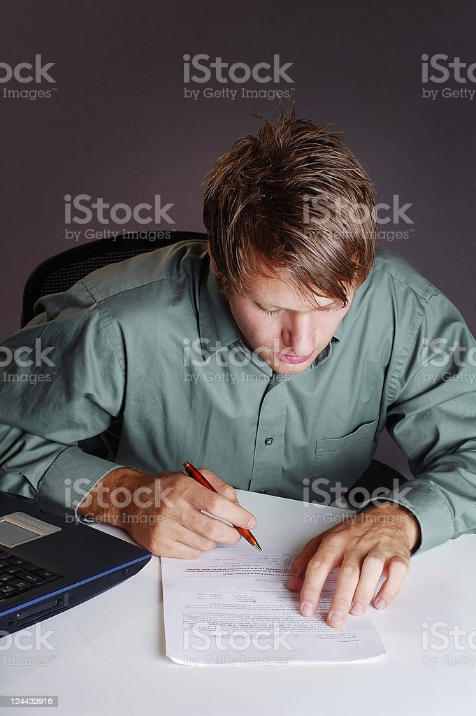 Business man reviews a contract royalty-free stock photo