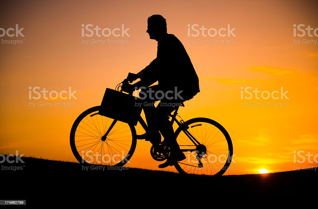 business man riding the bicycle royalty-free stock photo